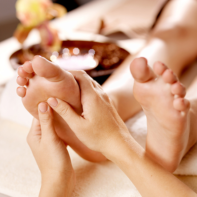 16578443 - massage of human foot in spa salon - soft focus image